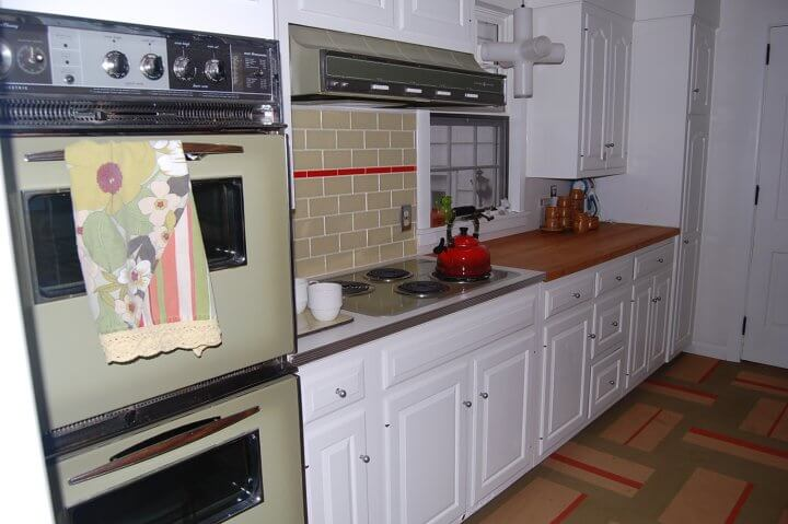 50s kitchen with avocado stove, range top and hood