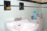 The mint tile bathroom with black bullnose, liner tile and recessed soap dishes