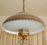 A pull down coppertone light in the dining area