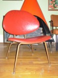 Red vinyl clamshell chair