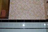 70s vintage wallpaper in the mint bathroom