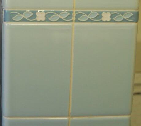 1960s-blue-tile-with-decorative-flower-liner