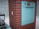 aquamarine-oven-in-brick-wall