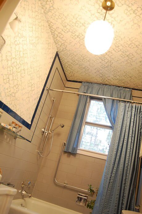 blue-and-gray-bathroom-with-wallpaper-wall-and-ceiling