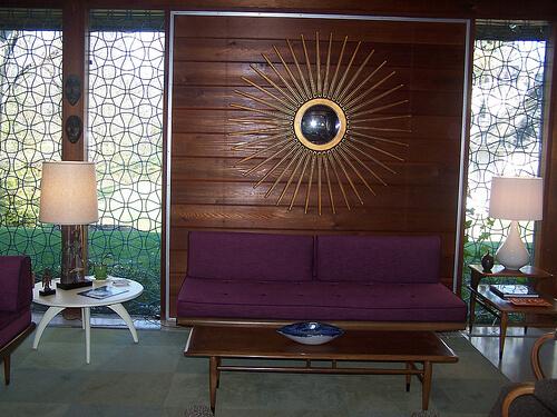 purple-sofa-and-starburst-mirror