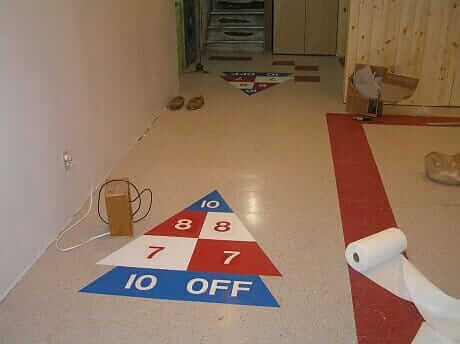 shuffleboard-in-Retro-Renovation-basement