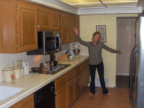 connie in her kitchen painted with rustoleum cabinet transformations