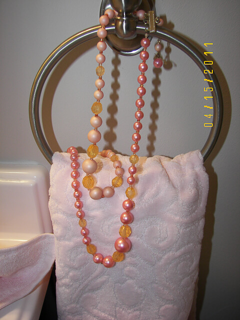 bathroom towels decorated with vintage costume jewelry