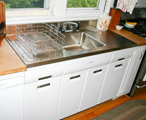 ... stainless steel drainboard sink installed onto a vintage steel kitchen