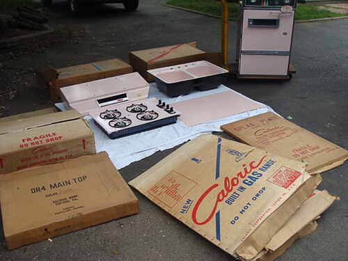 New Old Stock pink Caloric kitchen appliances found in trash pile