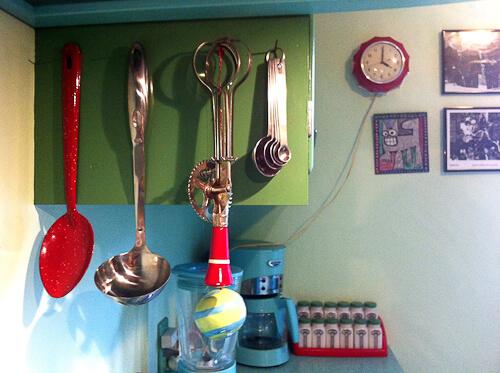 vintage red utensils in jadeite color kitchen
