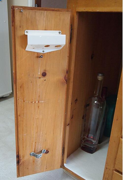 knotty pine kitchen with weird holder