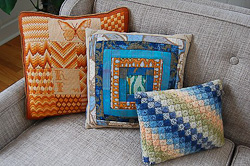 orange and rimini blu pillows