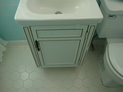 vintage vanity with hex floor tile