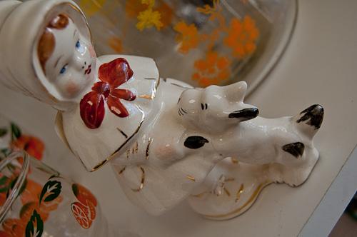 porcelain girl with dog