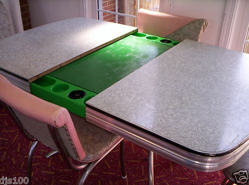 a kitchen table that opens to reveal a poker table -- a Playdine