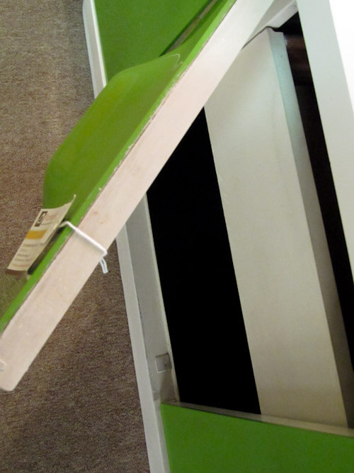 how green plastic is adhered to the door of broyhill 1970s plastic furniture