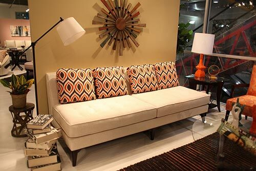 Armless-sofa-with-patterned-pillows-Younger-Ave-62