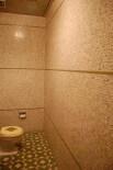 bathroom with metallic tile