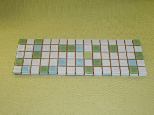 vintage-mosaic-tile-on-green-counter