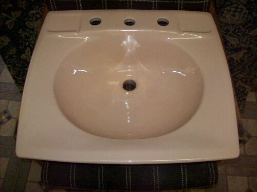 Light pink ceramic 19 and a half inches X 21 and a half inches 8 inch spread lavatory sink