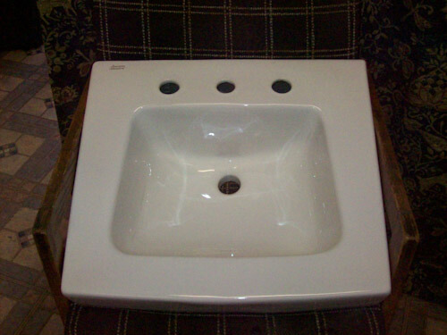 White  ceramic 20  and a half inches x  19 and a half inches 8 inch spread wall hung lavatory sink