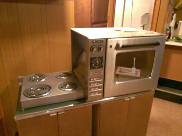 Countertop Stove Prices : countertop-height Hotpoint oven with hideaway fold-down electric range ...