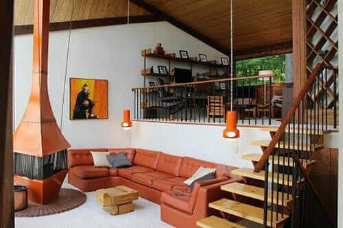 mid century living room with freestanding fireplace - 70s Home Design