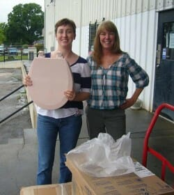 Amber and Caroline with Amber's long awaited pink potty at Gateway Supply.