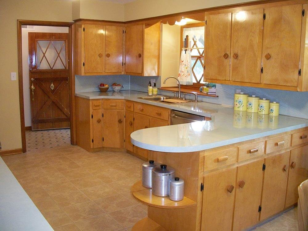 A family rebuilds and restores a 1953 kitchen to its for Restoring old kitchen cabinets