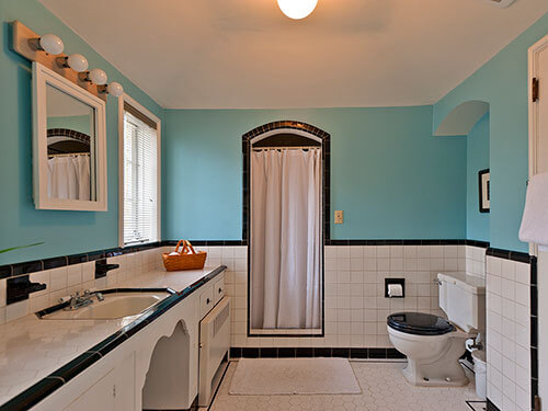 Black and white tile bathrooms done 6 different ways for Bathroom design 1930 s home