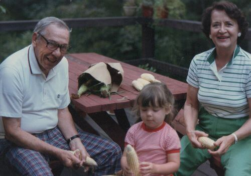 Many of my favorite childhood memories don't include stuff, it is about spending time with people you love. Above: Helping Bob and Nana shuck corn for dinner during their visit in 1985.