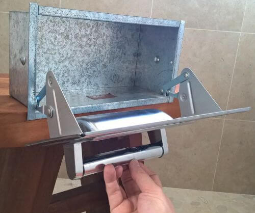 vintage conceal-a-roll toilet paper holder