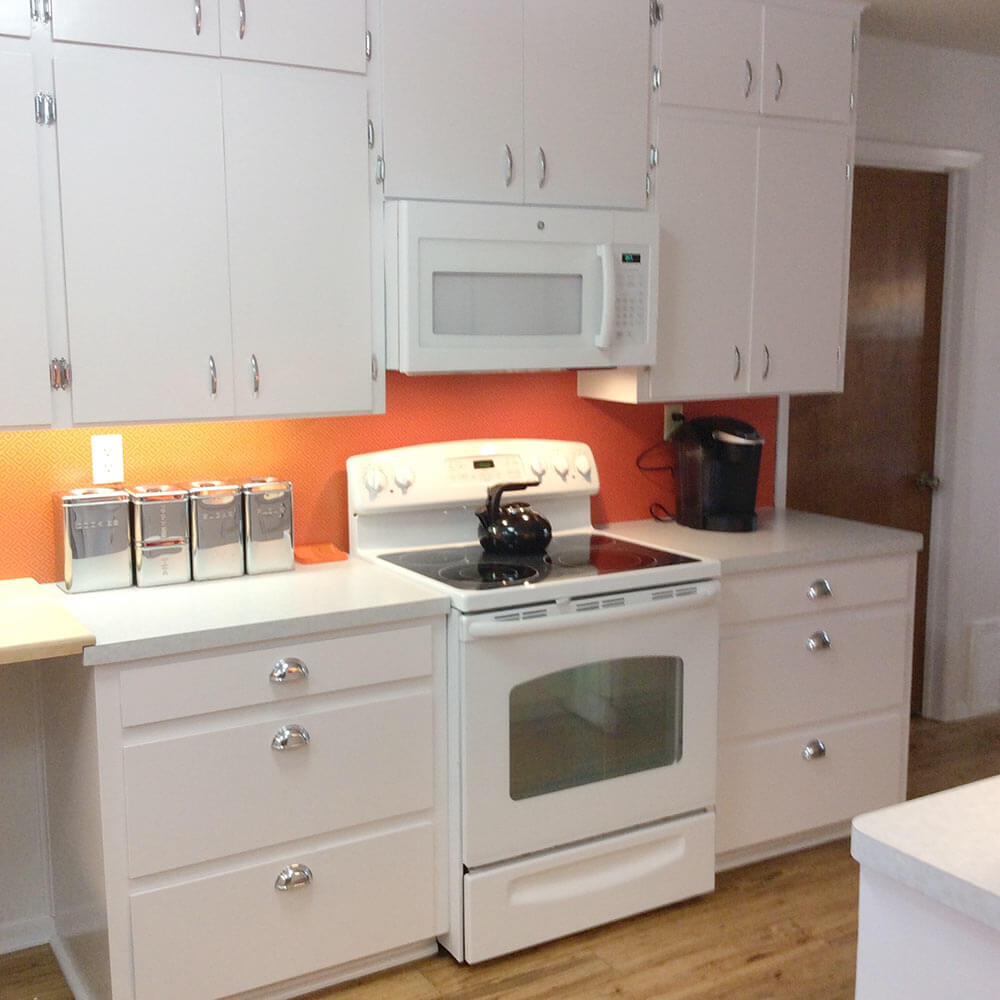Orange And White Kitchen Mary And John Remodel Their 1980s Kitchen With A Fresh White Retro