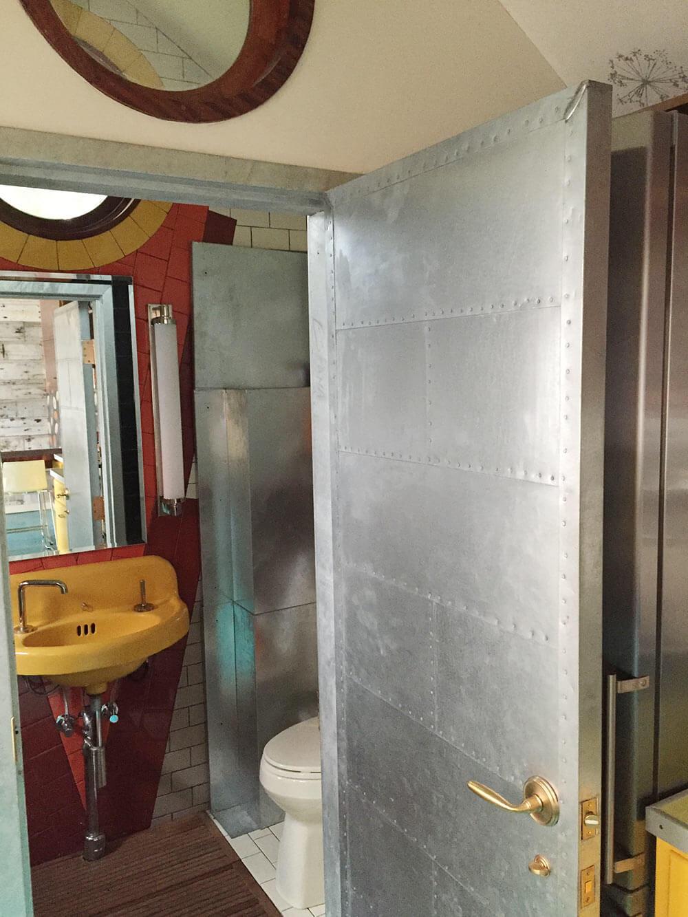 Thomas creates a genius retro modern eclectic office for Modern industrial bathroom