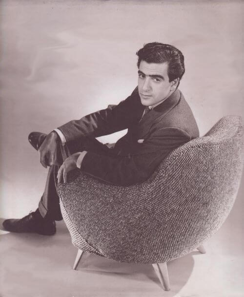 VLADIMIR KAGAN IN HIS SIGNATURE 100A BARREL CHAIR 1950S