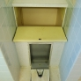 Vintage-bathroom-laundry-chute-and-recessed-scale.jpg