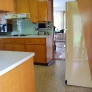 look-at-how-refrigerator-is-recessed-in-cabinetry-in-angular-fashion.jpg