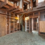70s-wood-paneled-living-room-with-beams