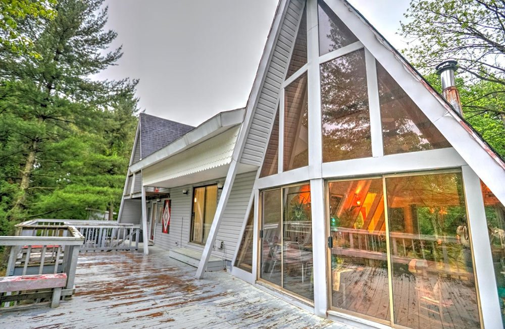 A 1974 double a frame time capsule house twice the fun for Cost to build mid century modern home