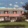 1969-large-pink-siding-house-landscape