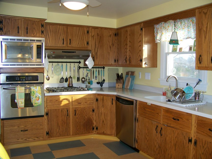 1963 Retro Oak Kitchen Yellow and Aqua Linoleum Floors Diana's early 60s oak kitchen with plank doors and colonial hardware