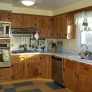 1963-retro-oak-kitchen-yellow-and-aqua-linoleum-floors.jpg