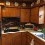 knotty-pine-kitchen-1-a1e38234fc8cafcb9c79fbb6c3ba0b99ad299c4f