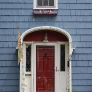 1920s-blue-house-with-red-door