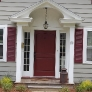 grey-colonial-house-with-burgundy-door