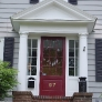 grey-colonial-house-with-red-door