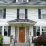 white-colonial-house-with-oak-door