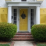 white-stucco-house-with-yellow-shutters