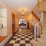 checkerboard-floor-entry-with-curved-staircase